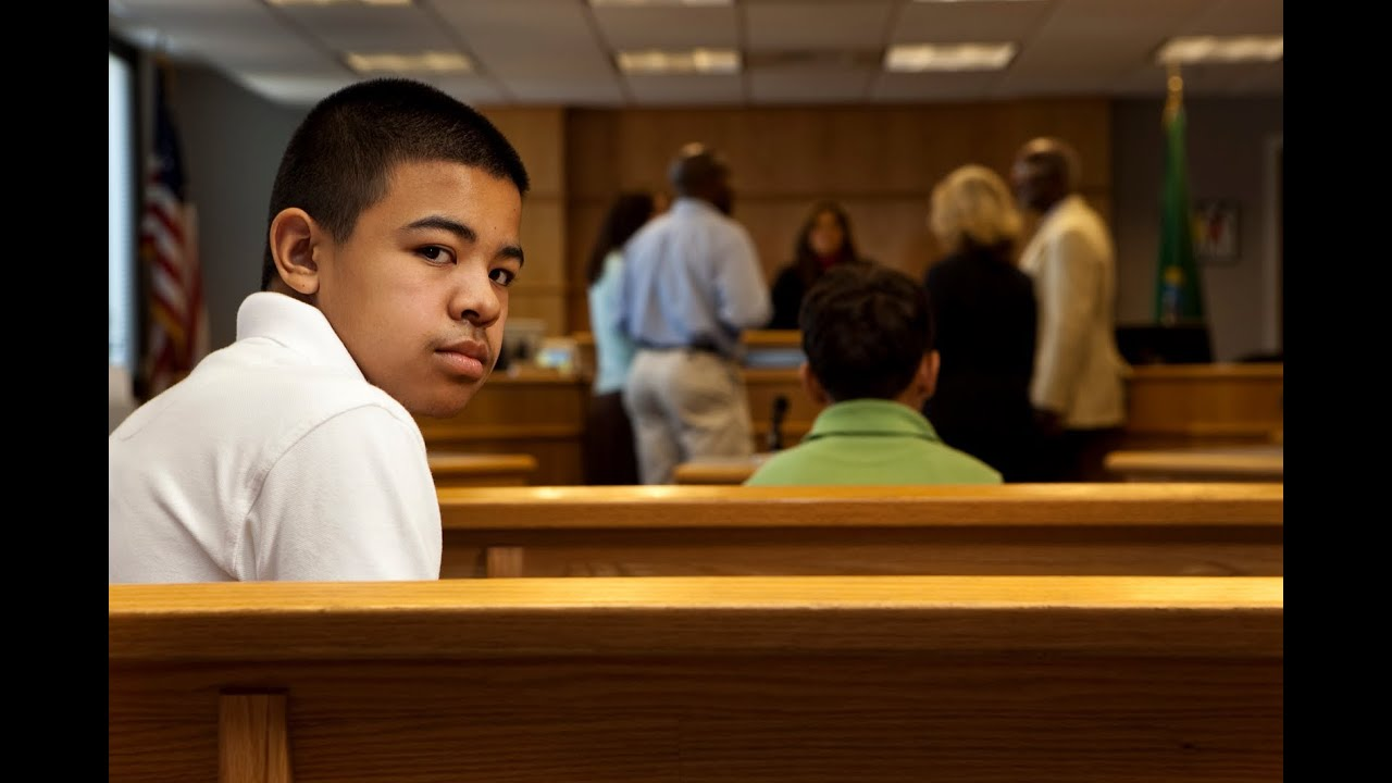 young boy in court wearing a whit t-shirt
